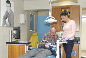 Dr Pretorius and another one of our professional oral hygienists attending to a patient.